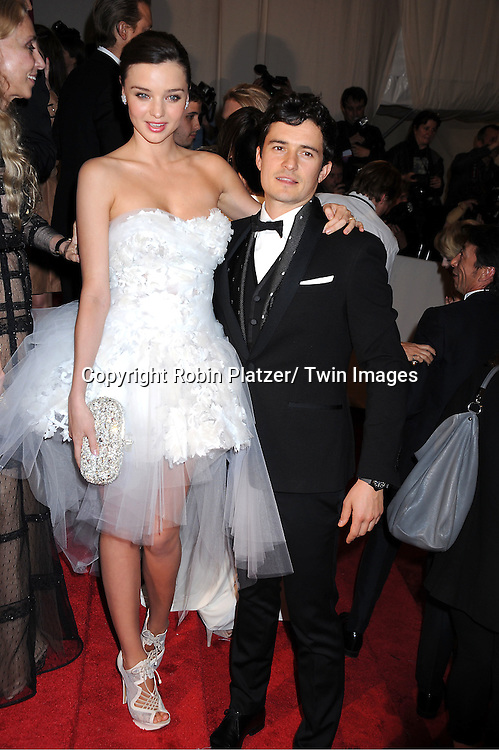 "Miranda Kerr and Orlando Bloom arriving at The Costume Institute Gala Benefit celebriting ""Alexander McQueen: Savage Beauty"" at The Metropolitan Museum of Art in New York City on May 2, 2011."