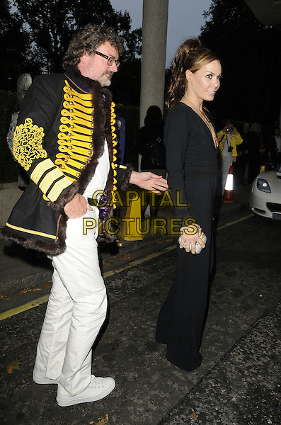 TARA PALMER-TOMKINSON.Freddie For A Day charity gala arrivals, Savoy hotel, the Strand, London, England..September 5th, 2011.full length black jumpsuit side profile tpt.CAP/CAN.©Can Nguyen/Capital Pictures.