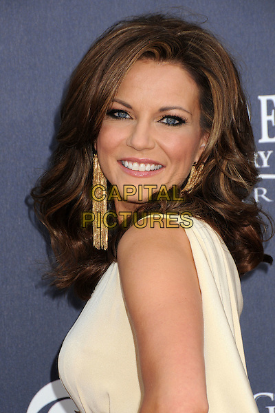 MARTINA McBRIDE .46th Annual Academy of Country Music Awards - Arrivals held at the MGM Grand Garden Arena, Las Vegas, Nevada, USA, 3rd April 2011..portrait headshot  beauty make-up gold tassel dangly earrings side smiling one shoulder white cream  .CAP/ADM/BP.©Byron Purvis/AdMedia/Capital Pictures.