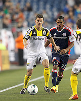 Columbus Crew midfielder Bernardo Anor (7) controls the ball as New England Revolution forward Jerry Bengtson (27) closes. In a Major League Soccer (MLS) match, the New England Revolution (blue) defeated Columbus Crew (white), 3-2, at Gillette Stadium on October 19, 2013.