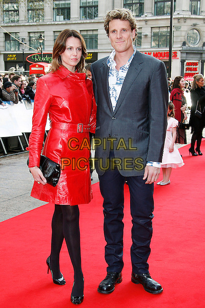 "BEVERLY TURNER & JAMES CRACKNELL.Arriving at the UK Film Premiere for ""Flashbacks Of A Fool"", Empire Leicester Square, London, England, .April 13th 2008. .full length red leather coat belt black clutch bag purse suit jacket .CAP/DAR.©Darwin/Capital Pictures"