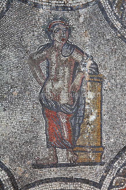 Figure leaning on a pillar, from the Roman mosaic of the Four Seasons, in the dining room of the House of Dionysos, 3rd century AD, Volubilis, Northern Morocco. Volubilis was founded in the 3rd century BC by the Phoenicians and was a Roman settlement from the 1st century AD. Volubilis was a thriving Roman olive growing town until 280 AD and was settled until the 11th century. The buildings were largely destroyed by an earthquake in the 18th century and have since been excavated and partly restored. Volubilis was listed as a UNESCO World Heritage Site in 1997. Picture by Manuel Cohen