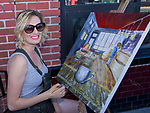 Painter Hayley Meadows at the Midtown Art Walk on Thursday afternoon in Reno, June 28, 2018.