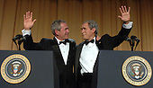 United States President  George W. Bush (L) and his inner monologue, played by Steve Bridges, entertain guests at the White House Correspondents' Association Dinner in Washington on April 29, 2006.  .Credit: Roger L. Wollenberg - Pool via CNP.