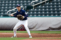 Brandon Healy (14) of the Oral Roberts Golden Eagles fields a ground ball near first base during a game against the Missouri State Bears on March 27, 2011 at Hammons Field in Springfield, Missouri.  Photo By David Welker/Four Seam Images