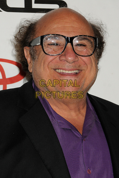 Danny DeVito.2012 Environmental Media Awards held at Warner Bros. Studios, Burbank, California, USA, 29th September 2012..portrait headshot  glasses purple shirt black smiling .CAP/ADM/BP.©Byron Purvis/AdMedia/Capital Pictures.