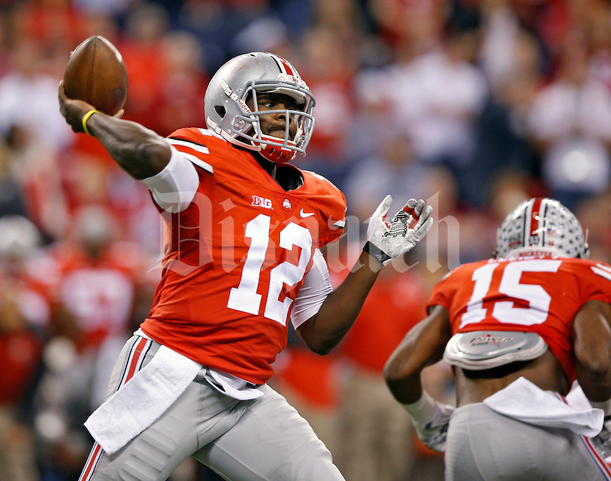 Ohio State Buckeyes quarterback Cardale Jones (12) throws the ball to a receiver against Wisconsin Badgers during the 2nd quarter in the 2014 Big Ten Football Championship Game at Lucas Oil Stadium in Indianapolis, Ind. on December 6, 2014.  (Dispatch photo by Kyle Robertson)