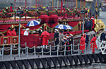 """THE QUEEN AND DUKE OF EDINBURGH .disembark from the """"Spirit of Chartwell"""" after participating in the Thames Pageant..They were joined by Prince Charles, Camilla, Duchess of Cornwall and Prince Harry for the procession up the Thames to mark the Diamond Jubilee of Queen Elizabeth ll..The Royals braved a toprrential downpour as they watched the flotilla of 1,000 boats file past them alongside the HMS President, Katherine Docks, London_03/06/2012.Mandatory credit photo: ©DIASIMAGES..(Failure to credit will incur a surcharge of 100% of reproduction fees)..                **ALL FEES PAYABLE TO: """"NEWSPIX INTERNATIONAL""""**..IMMEDIATE CONFIRMATION OF USAGE REQUIRED:.DiasImages, 31a Chinnery Hill, Bishop's Stortford, ENGLAND CM23 3PS.Tel:+441279 324672  ; Fax: +441279656877.Mobile:  07775681153.e-mail: info@newspixinternational.co.uk"""