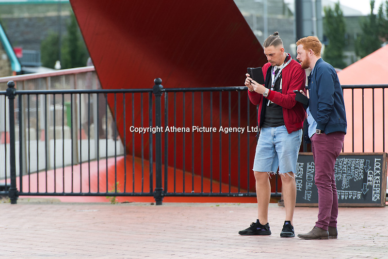 "CARDIFF, UK Despite not yet officially being released in the UK, people have found ways to access the new Pokemon Go app that has taken America by storm. <br /> <br /> People gathered in Cardiff Bay around ""Pokestops"" (usually landmarks, marked on the game's in-game map) which had had a ""Lure"" attached to them - an in-game method of attracting more Pokemon to an area, and with them, more users."