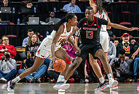 COLLEGE PARK, MD - FEBRUARY 9: Diamond Miller #14 of Maryland dribbles past Mael Gilles #13 of Rutgers during a game between Rutgers and Maryland at Xfinity Center on February 9, 2020 in College Park, Maryland.
