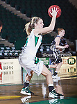 North Texas Mean Green guard Laura McCoy (4) in action during the game between the Troy Trojans and the University of North Texas Mean Green at the North Texas Coliseum,the Super Pit, in Denton, Texas. UNT defeats Troy 57 to 36.....