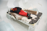 Sweden, SWE, Kiruna, 2006-Apr-12: A tourist lying on a bed in a bedroom of the Jukkasjarvi icehotel .