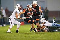 Verona's Sam Wood gets tied up by Middleton defenders Nick Kryshak (10), Devin Jackson (18) and Cooper Holewinski (bottom), as Wisconsin Big Eight Conference high school football between Middleton and Verona on Friday, 8/24/18 at Verona High School