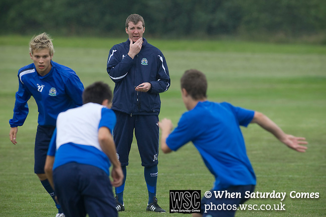 Stockport Pre-Season Training, 09/07/2008. Manor Farm, Timperley, League One. Stockport County manager Jim Gannon watching his players training during a pre-season training session at the club's training ground at Manor Farm, Timperley, Cheshire. Stockport County were promoted up to league One following a play-off final victory over Rochdale at Wembley in May, 2008. Jim Gannon took over as manager of the club in 2006 and lead them to promotion after three seasons in League Two. Photo by Colin McPherson.
