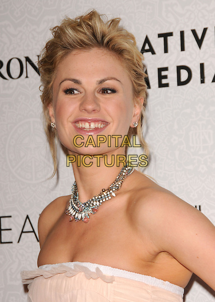 "ANNA PAQUIN.Art of Elysium 3rd Annual Black Tie charity gala '""Heaven"" held at 990 Wilshire Blvd in Beverly Hills, California, USA, .January 16th 2010 .headshot portrait necklace strapless smiling beige cream nude hair up beads charms .CAP/RKE/DVS .©DVS/RockinExposures/Capital Pictures"