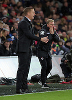 (L-R) Swansea manager Garry Monk and Bournemouth manager Eddie Howe during the Barclays Premier League match between Swansea City and Bournemouth at the Liberty Stadium, Swansea on November 21 2015