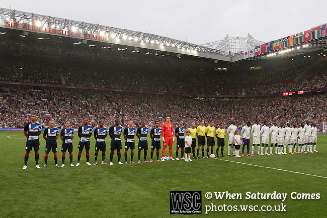 Uruguay 2 United Arab Emirates 1, Great Britain 1 Senegal 1, 26/07/2012. Old Trafford, Olympic Games. Great Britain and Senegal football teams line up on the field at Manchester United's Old Trafford stadium prior to their team's opening Men's Olympic Football tournament match at the venue. The double header of matches resulted in Uruguay defeating the United Arab Emirates by 2-1 while Great Britain and Senegal drew 1-1. Over 72,000 spectators attended the two Group A matches. Photo by Colin McPherson.