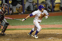 LSU Tigers outfielder Andrew Stevenson (6) follows through on his swing during a Southeastern Conference baseball game against the Texas A&M Aggies on April 23, 2015 at Alex Box Stadium in Baton Rouge, Louisiana. LSU defeated Texas A&M 4-3. (Andrew Woolley/Four Seam Images)