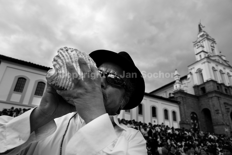 An Indian blows a shell trumpet during the Inti Raymi (San Juan) festivities in Cotacachi, Ecuador, 29 June 2010. 'La toma de la Plaza' (Taking of the square) is an ancient ritual kept by Andean indigenous communities. From the early morning of the feast day, various groups of San Juan dancers from remote mountain villages dance in a slow trot towards the main square of Cotacachi. Reaching the plaza, Indians start to dance around. They pound in synchronized dance rhythm, shout loudly, whistle and wave whips, showing the strength and aggression. Dancers from either the upper communities (El Topo) or the lower communities (La Calera), joined in respective coalitions, seek to conquer and dominate the square and do not let their rivals enter. If not moderated by the police in time, the high tension between groups always ends up in violent clashes.