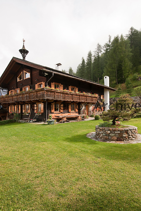 This typical Tyrolese chalet features a balcony that wraps around the perimeter of the building