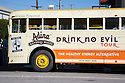 A close up of a vegetable oil powered tour bus outside the Green Festival in San Francisco. Bus promotes Adina fair trade certified drinks with slogans 'Drink No Evil' and 'The Healthy Energy Alternative'. San Francisco, California, USA