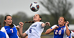 Freeburg midfielder Madison Schanz (5, center) heads the ball as she's flanked by Roxana players Kortni Laws (7, left) and Delaney Tyler. Roxana High School played a girls soccer game at Freeburg High School on Thursday May 3, 2018. Tim Vizer | Special to STLhighschoolsports.com