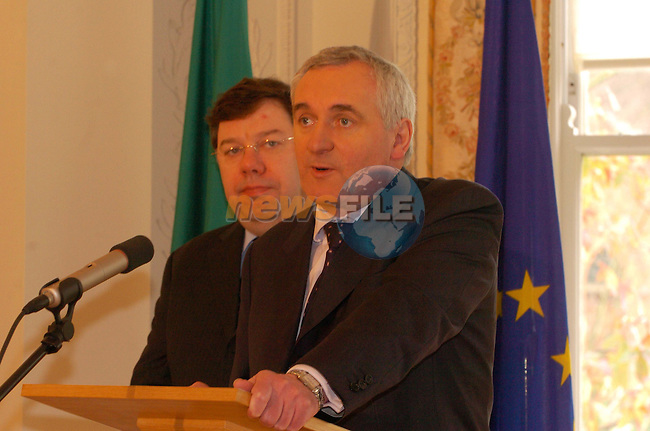 Dublin Ireland. Irish Prime Minister and President of the EU Bertie Ahern, (L) reading a statement to Irish Journalists after the ceremony for the presentation of the Macedonia application was cancelled because of the Tragic news that President Boris Trajkovski had died in a plane crash over Bosnia. Pictured with Irish Foreign Minister Brian Cowen at Farmleigh House, Pheonix Park, Dublin, Ireland 26th February 2004.Photo AFP/NEWSFILE/FRAN CAFFREY..(Photo credit should read FRAN CAFFREY/NEWSFILE/AFP)...This Picture has been sent you under the condtions enclosed by:.Newsfile Ltd..the Studio,.Millmount Abbey,.Drogheda,.Co Meath..Ireland..Tel: +353(0)41-9871240.Fax: +353(0)41-9871260.GSM: +353(0)86-2500958.email: pictures@newsfile.ie.www.newsfile.ie.FTP: 193.120.102.198..This picture is from Fran Caffrey@newsfile.ie