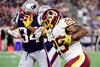 August 9, 2018: Washington Redskins running back Derrius Guice (29) stiff arms New England Patriots defensive back J.C. Jackson (34) as he moves the ball down the field during the NFL pre-season football game between the Washington Redskins and the New England Patriots at Gillette Stadium, in Foxborough, Massachusetts. The Patriots defeat the Redskins 26-17.  Eric Canha/CSM