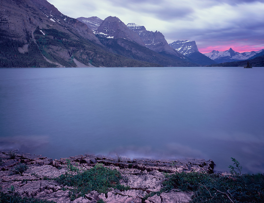 A calm day looking over the sunset at St. Mary Lake in Glacier National Park in Montana.