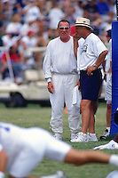 AUSTIN, TX - Owner Al Davis of the Oakland Raiders talks with head coach Barry Switzer of the Dallas Cowboys during training camp with the Dallas Cowboys in Austin, Texas in 1997. Photo by Brad Mangin