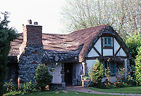 Vancouver: A cozy Cotswold Cottage, 3575 W. Broadway. Almost surely one of 3 such cottages by Ross A. Lort for Builder Brenton T. Lea in 1942. Photo '86.