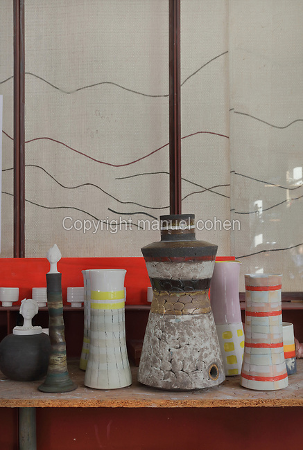 Collection of clay and porcelain vases in the studio of ceramicist Valeria Polsinelli, in Montreuil, a suburb of Paris, France. Polsinelli creates everyday vessels, water jugs, jewellery and figurines and stoppers of female busts, with features and hairstyles from various world cultures. Picture by Manuel Cohen