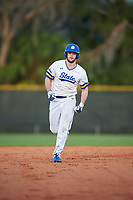 South Dakota State Jackrabbits center fielder Landon Badger (11) rounds the bases after hitting a home run during a game against the Northeastern Huskies on February 23, 2019 at North Charlotte Regional Park in Port Charlotte, Florida.  Northeastern defeated South Dakota State 12-9.  (Mike Janes/Four Seam Images)