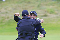 Shane Lowry (IRL) hugs caddy Brian Martin after they win the Championship by 6 shots at the end of Sunday's Final Round of the 148th Open Championship, Royal Portrush Golf Club, Portrush, County Antrim, Northern Ireland. 21/07/2019.<br /> Picture Eoin Clarke / Golffile.ie<br /> <br /> All photo usage must carry mandatory copyright credit (© Golffile | Eoin Clarke)