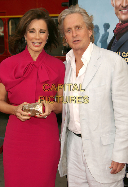 "ANNE ARCHER & MICHAEL DOUGLAS.""Ghosts Of Girlfriends Past"" Los Angeles Premiere held at Grauman's Chinese Theatre,  Hollywood, CA, USA..April 27th, 2009.half length pink shirt white shirt blue pale light suit jacket dress gold clutch bag .CAP/ADM/MJ.©Michael Jade/AdMedia/Capital Pictures."