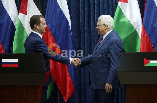 Palestinian President Mahmoud Abbas shake hands with Russian Prime Minister Dmitry Medvedev after a joint news conference in the West Bank city of Jericho November 11, 2016. Photo by Shadi Hatem