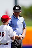 Third Base Umpire Jimmy Volpi talks with the Springfield Cardinals batboy during a game between the San Antonio Missions and the Springfield Cardinals on May 30, 2011 at Hammons Field in Springfield, Missouri.  Photo By David Welker/Four Seam Images.