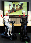 """September 29, 2017, Tokyo, Japan - Models display eleectric personal mobility """"Landboard"""" developed by Japanese automobile venture Exmachina at a press preview in Tokyo on Friday, September 29, 2017. Exmachina also displayed two-seater electric vehicle Earth-1 which enables to transform its body like a robot.   (Photo by Yoshio Tsunoda/AFLO) LWX -ytd-"""
