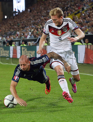 07.09.2014. Dortmund, Germany.   international match Germany Scotland  in Signal Iduna Park in Dortmund. Alan Hutton (Sco) is fouled by Andre Schurrle (GER)<br />