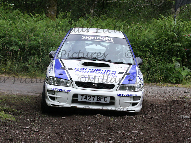 Mark McCulloch - Elliott Edmondson at junction 2 on Special Stage 6 Heathhall 2 on the Scottish Rally 2013, Round 3 of the BMSA British Rally Championship, Round 5 of the RAC MSA Scottish Rally Championship sponsored by ARR Craib Transport Limited and Round 7 of the Motoscope Northern Historic Rally Championship which was organised by the Royal Scottish Automobile Club and based at Dumfries on 29.6.13.