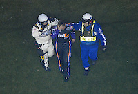 Feb 10, 2007; Daytona, FL, USA; Nascar Nextel Cup driver Denny Hamlin (11) is led to the ambulance after crashing on the last lap during the Budweiser Shootout at Daytona International Speedway. Mandatory Credit: Mark J. Rebilas