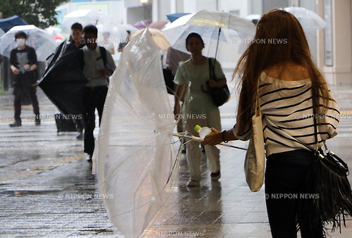 August 22, 2016, Tokyo, Japan - Pedestrians walk against strong wind and heavy rain in Tokyo on Monday, August 22, 2016. A powerfull typhoon Mindulle hit Tokyo metropolitan area, bringing torrential rain and strong wind.    (Photo by Yoshio Tsunoda/AFLO) LWX -ytd-