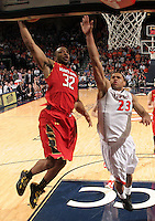 Maryland guard/forward Dez Wells (32) goes to dunk the ball in front of Virginia guard Justin Anderson (23) during the game Sunday in Charlottesville, VA. Virginia defeated Maryland in overtime 61-58.Photo/Andrew Shurtleff