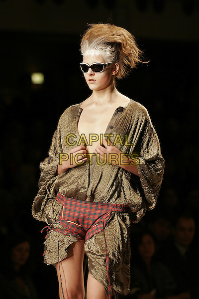 MODEL.Vivienne Westwood ready to wear Spring/Summer Collection 2005, Paris, France, .October 5th 2004..half length sunglasses red tartan knickers pants green  khaki shirt  fashion show catwalk white powder hair talc.Ref: MDS.www.capitalpictures.com.sales@capitalpictures.com.©O.Medias/Capital Pictures .