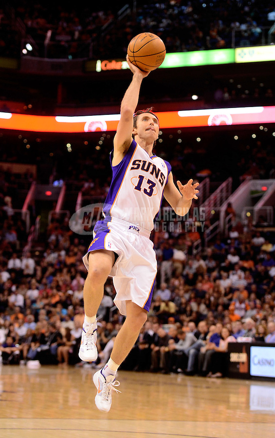Apr. 18, 2012; Phoenix, AZ, USA; Phoenix Suns guard Steve Nash takes a shot in the second half against the Oklahoma City Thunder at the US Airways Center. Mandatory Credit: Mark J. Rebilas-