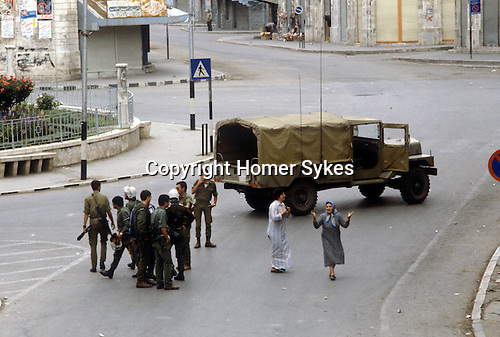 Nablus West Bank Israel. Israeli soldiers Palestinian women, despair, they have just been firing on demonstrators.   1980s Middle East.