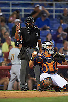 Umpire Jeremie Rehak makes a call behind catcher Xorge Carrillo (44) during a game between the Trenton Thunder and Binghamton Mets on August 8, 2015 at NYSEG Stadium in Binghamton, New York.  Trenton defeated Binghamton 4-2.  (Mike Janes/Four Seam Images)