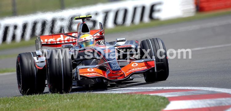 **ALL ROUND PICTURES FROM SOLARPIX.COM**.**WORLDWIDE SYNDICATION RIGHTS**.British driver Lewis Hamilton in his Mclaeren F1 in action after claiming pole postion for tomorrow's Grand Prix at the Silverstone race circuit. Hamilton leads the F1 championship by 14 points from team mate F.Alonso..JOB REF:  4229    STN       DATE: 07.07.07.**MUST CREDIT SOLARPIX.COM OR DOUBLE FEE WILL BE CHARGED* *UNDER NO CIRCUMSTANCES IS THIS IMAGE TO BE REPRODUCED FOR ANY ONLINE EDITION WITHOUT PRIOR PERMISSION*