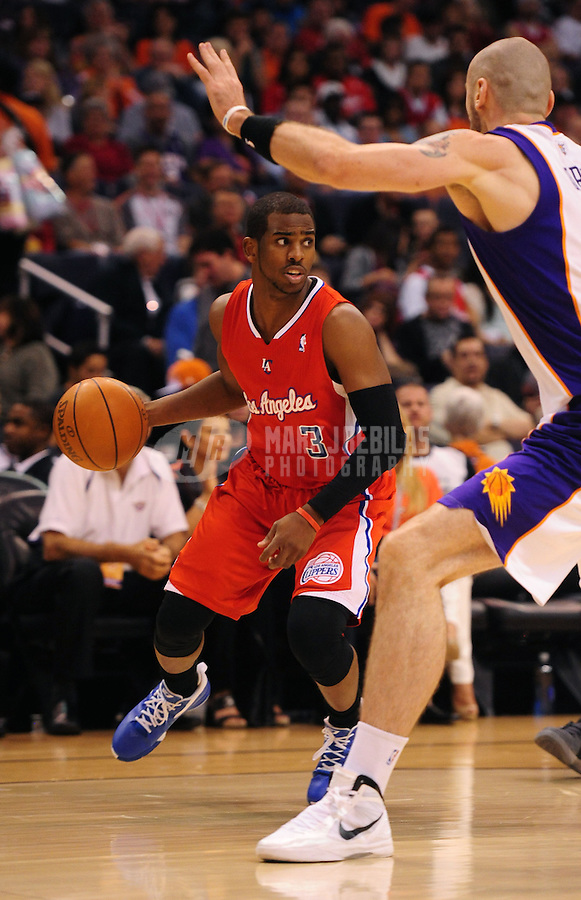 Mar. 2, 2012; Phoenix, AZ, USA; Los Angeles Clippers guard Chris Paul controls the ball against the Phoenix Suns at the US Airways Center. The Suns defeated the Clippers 81-78. Mandatory Credit: Mark J. Rebilas-USA TODAY Sports