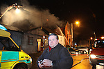 Fire fighters from Drogheda, Dunleer and Dundalk with seven fire appliances fought a fire in Drogheda Borough ouncil offices which destroyed the Council chamber, Planing section and housing section. The fire fighter managed to stop the spread of the fire into the rest of the offices in Fair street in Drogheda..Cllr Paul Bell watches as the fire destroys the council chamber ..Photo: Fran Caffrey/www.newsfile.ie...